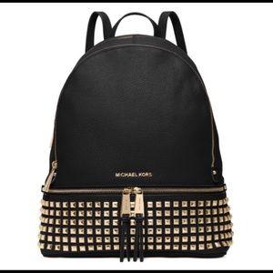 Michael Kors medium rhea black and gold backpack